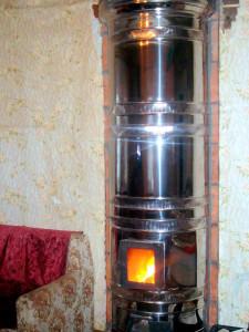 Печь-голландка в круглом футляре из нержавеющей стали
